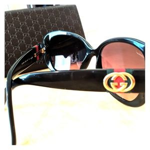 Never worn Gucci Sunglasses